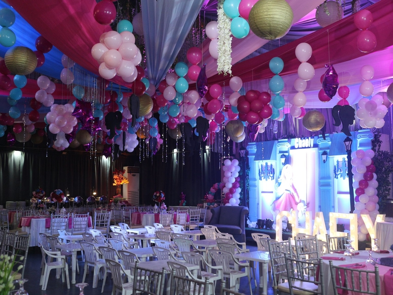 debut event with pink theme of decoration and a lot of hanging balloon on the ceiling