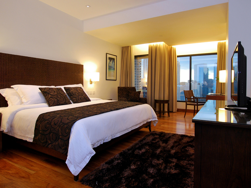 hotel bedroom with the panoramic view of the city