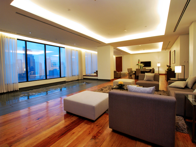 executive suite of the hotel featuring the living room and dining room