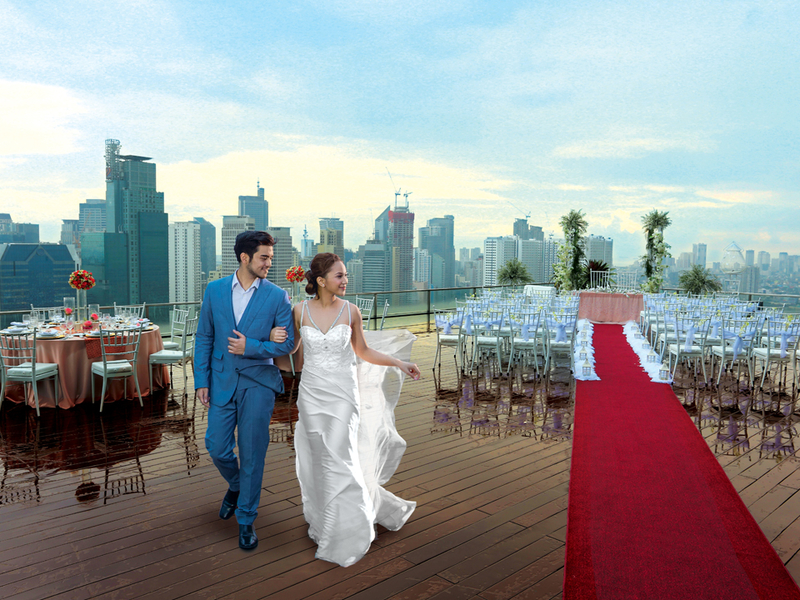 couples are doing their wedding photoshoot at the rooftop area