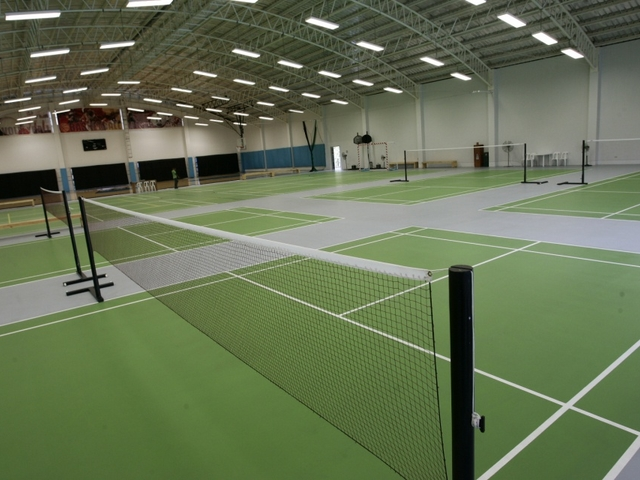large badminton hall with several fields and high ceiling in philippines