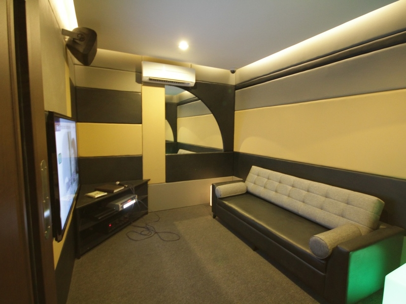 small karaoke room with black long couch in philippines event venue