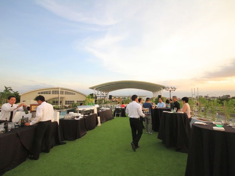 paranaque rooftop party space with black cocktail table and garden view