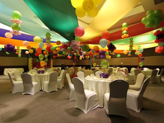 colourful kids birthday party venue in paranaque with balloons decorations and white banquet seating