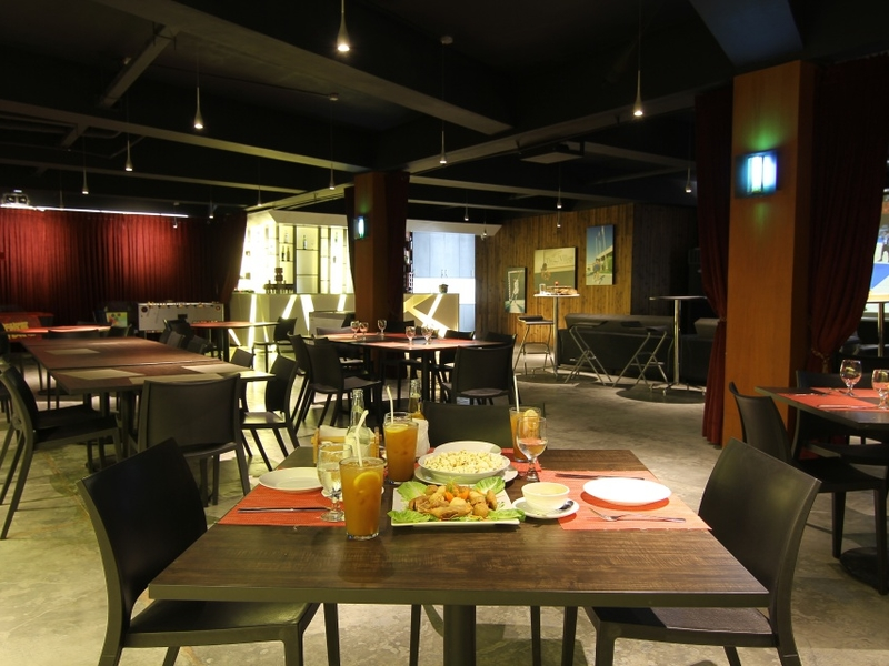 black theme live music space in paranaque with square dining table