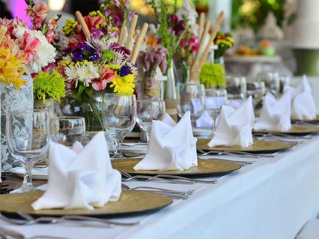 white dining table decorated with colourful flowers in philippines event venue