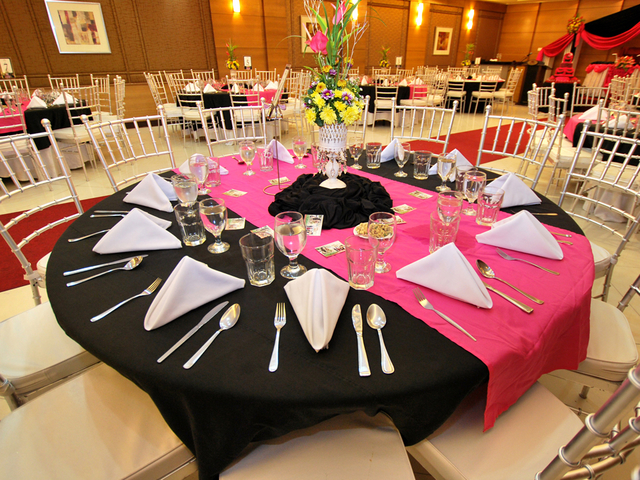 banquet style of wedding party with black and red tablecloth