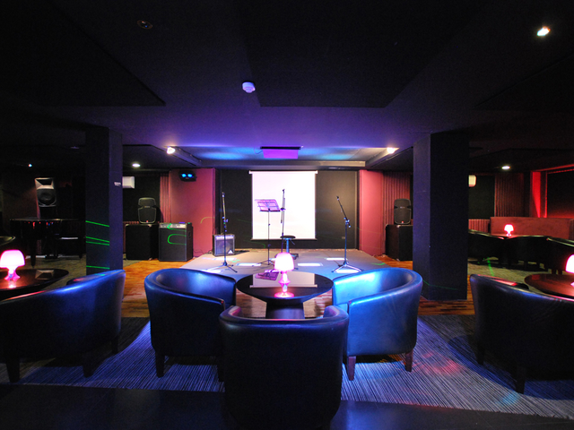 lounge area featuring the stage for live music event