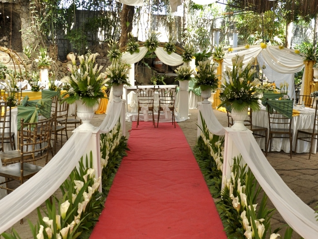 wedding aisle decorated with flowers