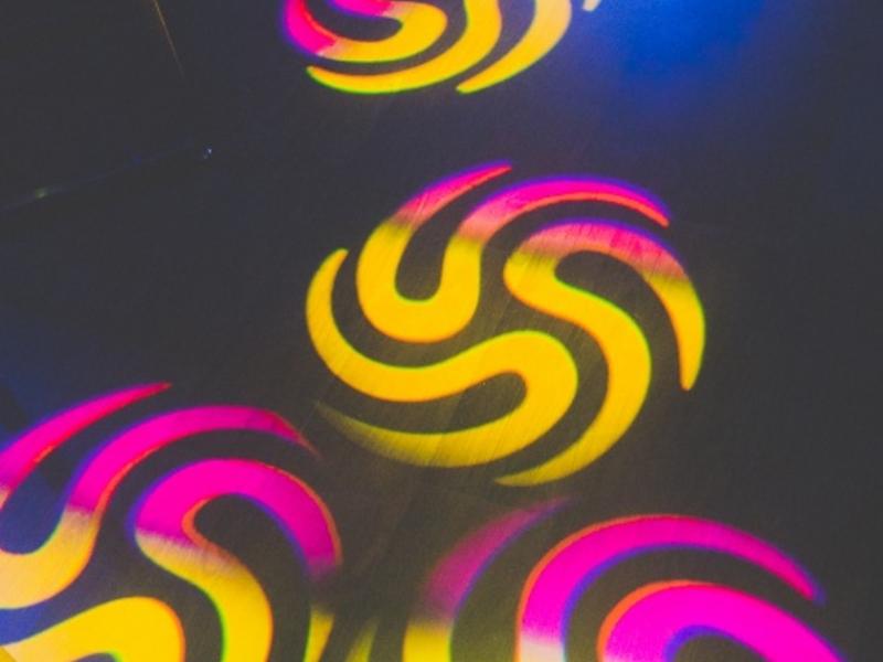 light projection on club dancefloor