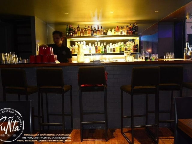 bartender working behind bar
