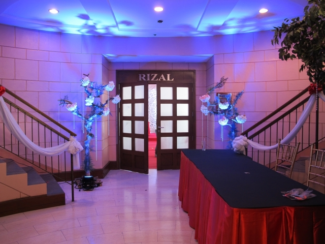 manila christmas party space with stairs and long table at the entrance