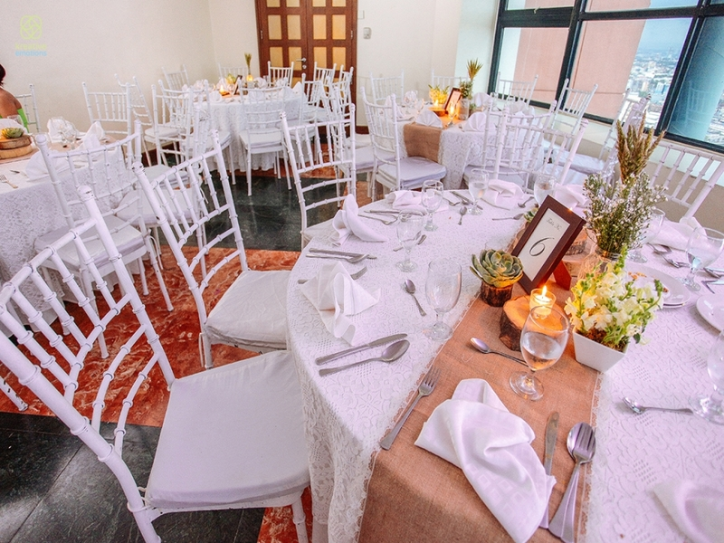 manila party venue with white banquet seating and big windows