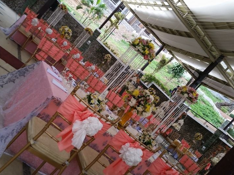 flowers decorations and long pink dining table in philippines wedding venue