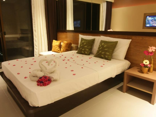 small bedroom with tv screen in philippines team building venue