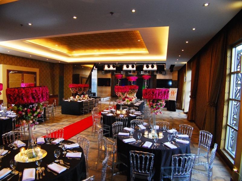 function room decorated for wedding reception using banquet style