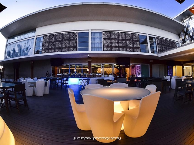 rooftop area equipped with buffet line for party