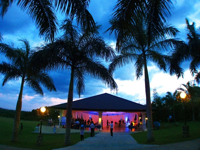 philippines indoor party space with large garden area and surrounded by coconut tree