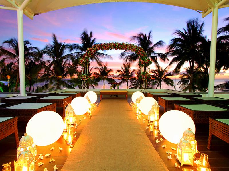 wedding aisle decorated with light bulbs