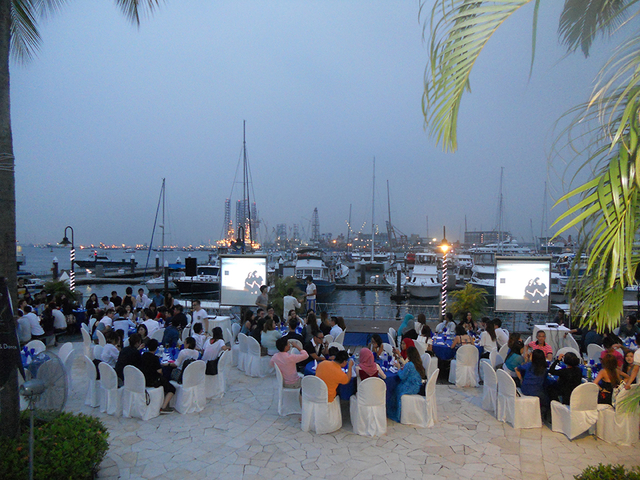 large seaside venue in singapore with banquet seating and projector screens