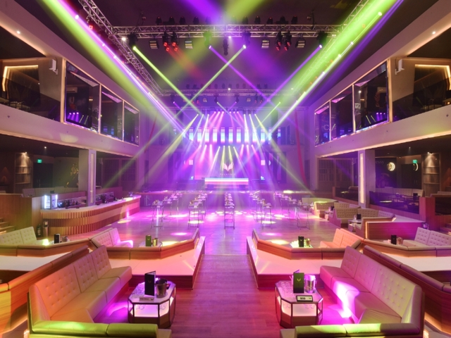corporate year-end party event venue in taguig with colourful track lights and mini large stage