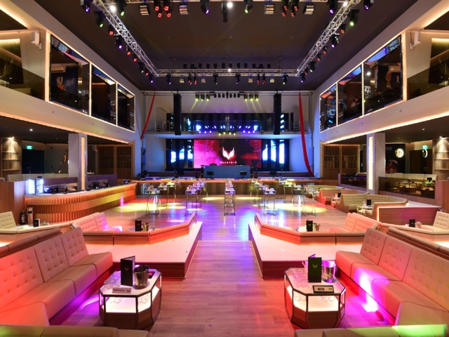 high ceiling bachelor party event venue in philippines with several long couches and track lights