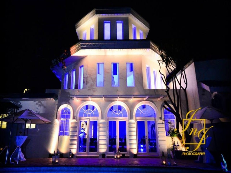 the exterior building of felicidad mansion events place at night