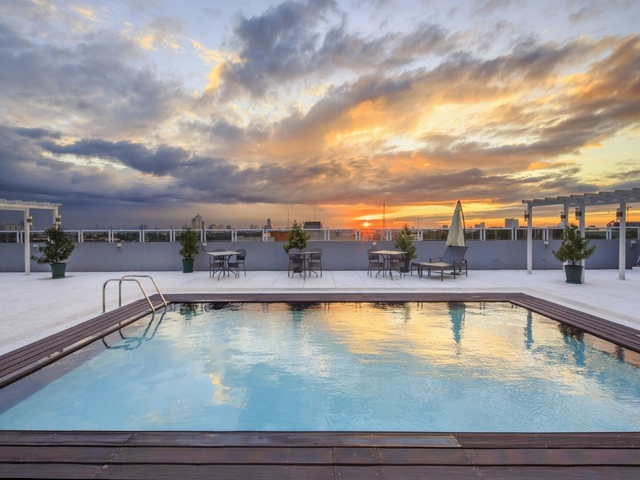 swimming pool overseeing sunset