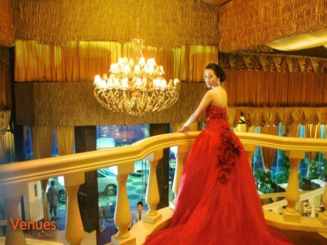 crystal chandelier; bride holding on to railings in hotel