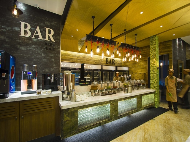 bar area with various selection of alcohol drinks and wine