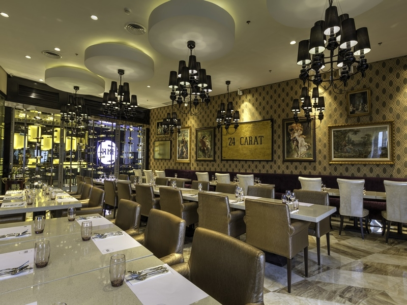 rows of dining tables; chandelier