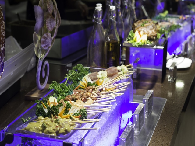 buffet line with glass bottles behind