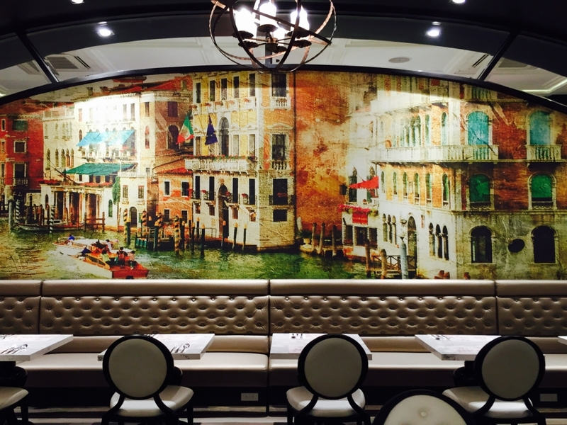 makati large restaurant with wall painting and long couch
