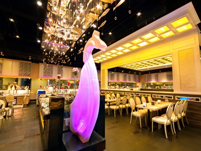 product launch space with purple art installation and  high ceiling