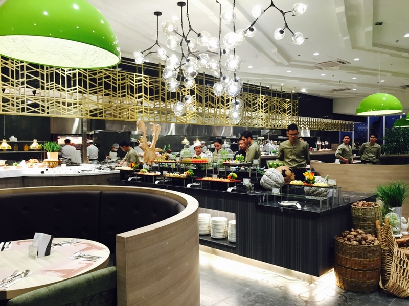 large birthday venue in paranaque with black buffet table and green pendant lamps