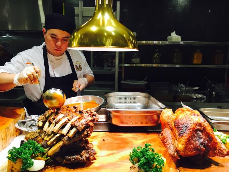 paranaque restaurant's chef serving turkey in the kitchen