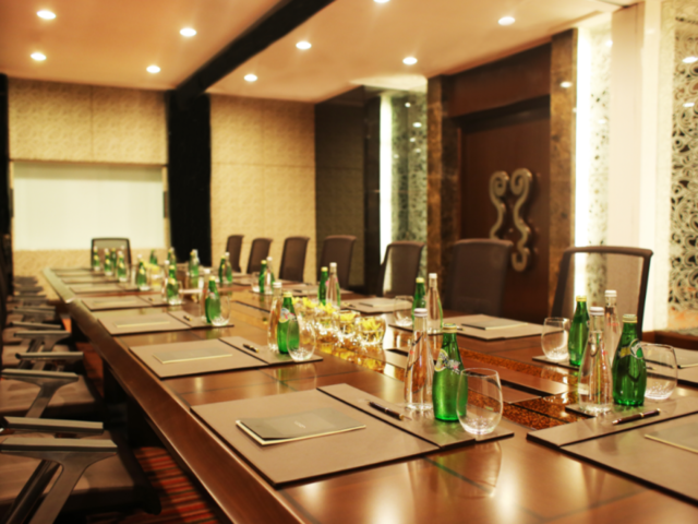 luxury hotel conference room; memo and sparkling water on table