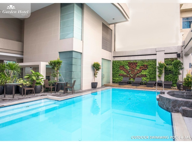 outdoor swimming pool and jacuzzi situated at the top most floor of the hotel