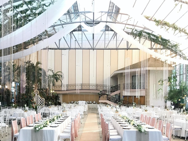 venue with imposing high ceilings and lush garden landscapes