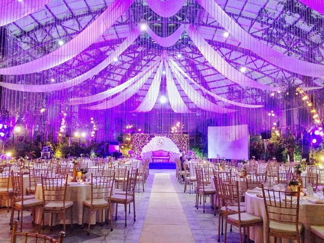wedding reception with banquet style and purple lighting