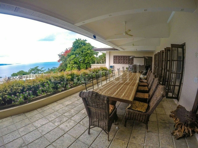 balcony with dining table in tali beach house