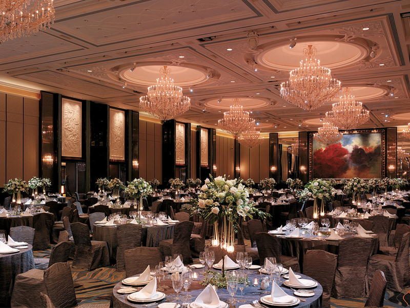 ballroom with banquet dining tables and flowers decorations