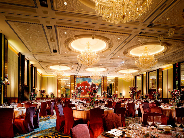 red banquet seatings and golden pendant lights in function room
