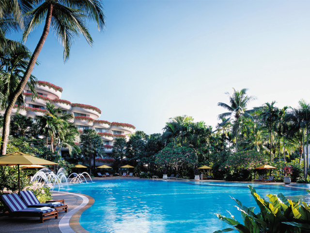five-star hotel in singapore with large outdoor pool and garden view