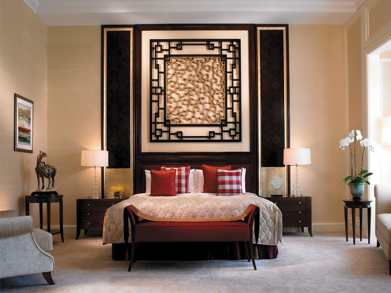 warm ambience bedroom with patterned wall decor and high ceiling