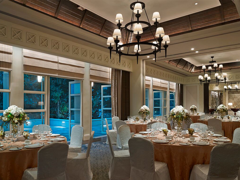 corporate dinner in function room singapore with banquette seating
