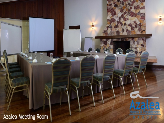 private meeting room equipped with screen projector and standing flipchart