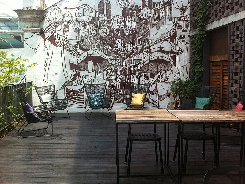 rooftop outdoor cafe with graffiti