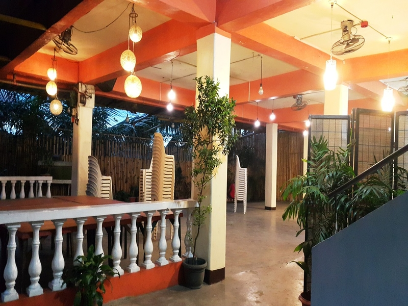 indoor wedding space in navotas with several pillars and plants around