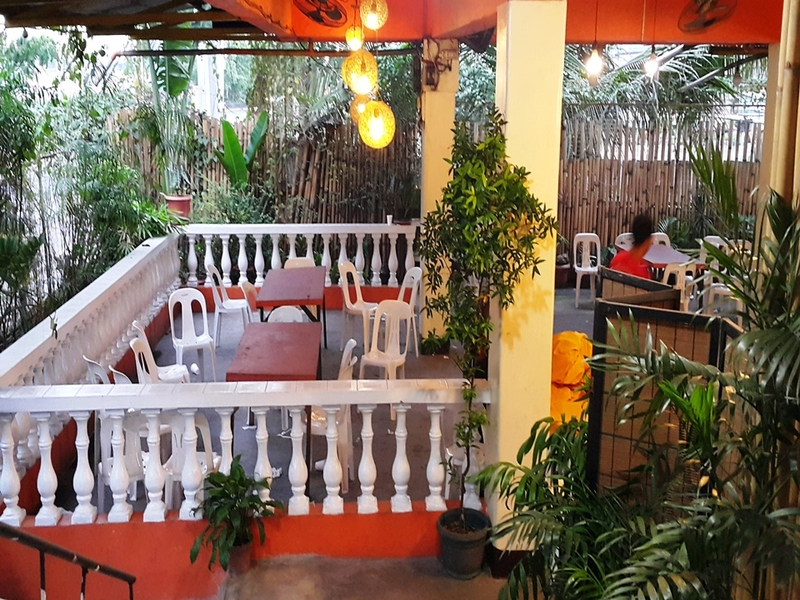 semi open-air team bonding space in navotas with high ceiling and plants around